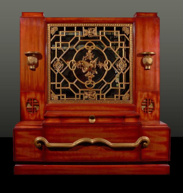 Fig. 6. Console, designed by Mont, c.1950. Lacquered maple with carved wood elements salvaged from a theater in Brooklyn, gilding, and smoked mirror; height 79, width 78, depth 20 inches. Merrill collection.