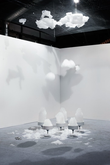 "Asif Khan of Britain, the second of the Designers of the Future Award winners, showed ""Cloud,"" an installation in which helium gas, water and soap combined to create clouds that rose to the ceiling to create patterns of light and shade on the floor"