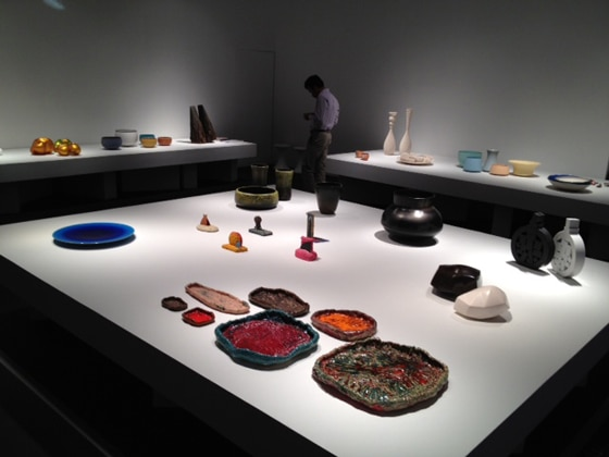 Sterling Ruby ashtrays in the foreground at Pierre Marie Giraud