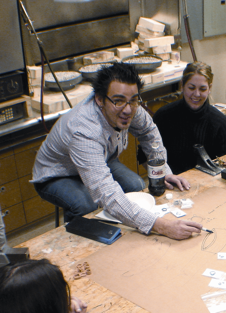 Doug Bucci (1971-) in the classroom as a visiting artist at Ferris State University, Grand Rapids, Michigan, 2012. Photograph by Phil Renato.