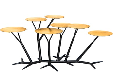 The black iron legs of Eric Robin's coffee table evoke tree branches, juxtaposed with the seven gold-leafed circular tops.