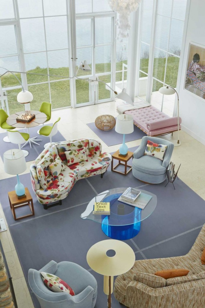 This Shelter Island residence features two Edward Wormley corner sofas for Dunbar, of similar shape but slightly different proportions, covered in two very different fabrics. Swivel chairs, also by Wormley, are covered in light-blue velvet and are arranged around a coffee table in the shape of an eye, designed by Nicola L. A large FilzFelt rug completes the room's main seating area. (Credit: Courtesy of The Monacelli Press / Anastassios Mentis)