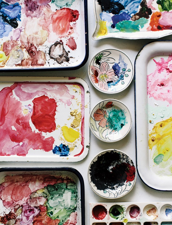 Some of her own dishes serve as paint palettes.