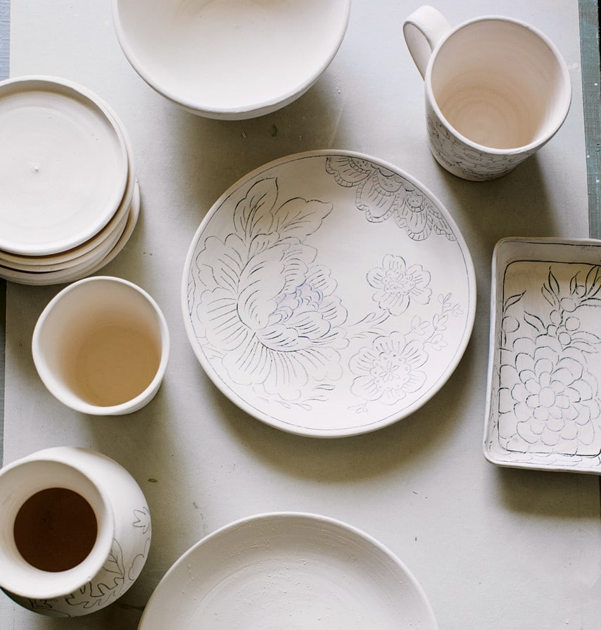 A collection of unfinished pieces await paint.