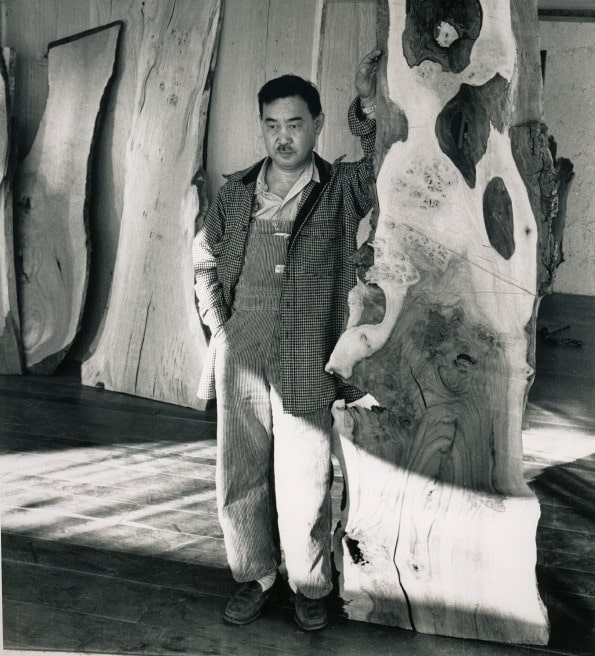 The work of American Craft pioneer George Nakashima, seen here in the 1950s with a slab of wood, his medium of choice, has never been more in demand (photo courtesy of Nakashima Studio). Top: New York dealer Todd Merrill recently acquired a remarkable suite of the creator's furniture.