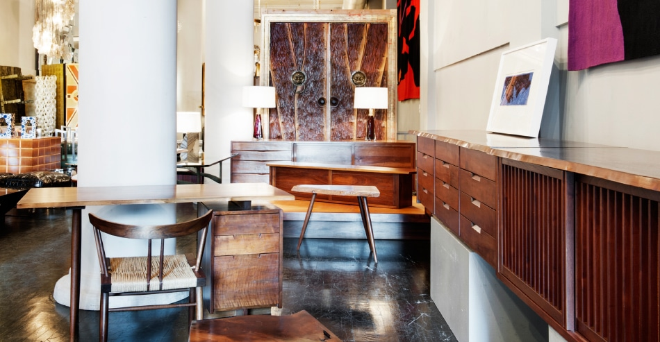 The suite of Nakashima furniture at Todd Merrill, including the console, at right, came from a single family who lived near Philadelphia and commissioned pieces from the woodworker from the 1950s through the 1970s; every item comes with the original invoice from the studio.