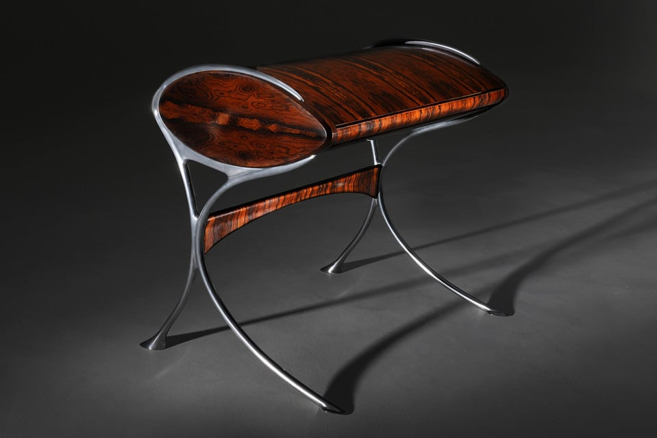 L'Orchidée desk, carved from rosewood with aluminium legs, is inspired by the Louis Majorelle design.